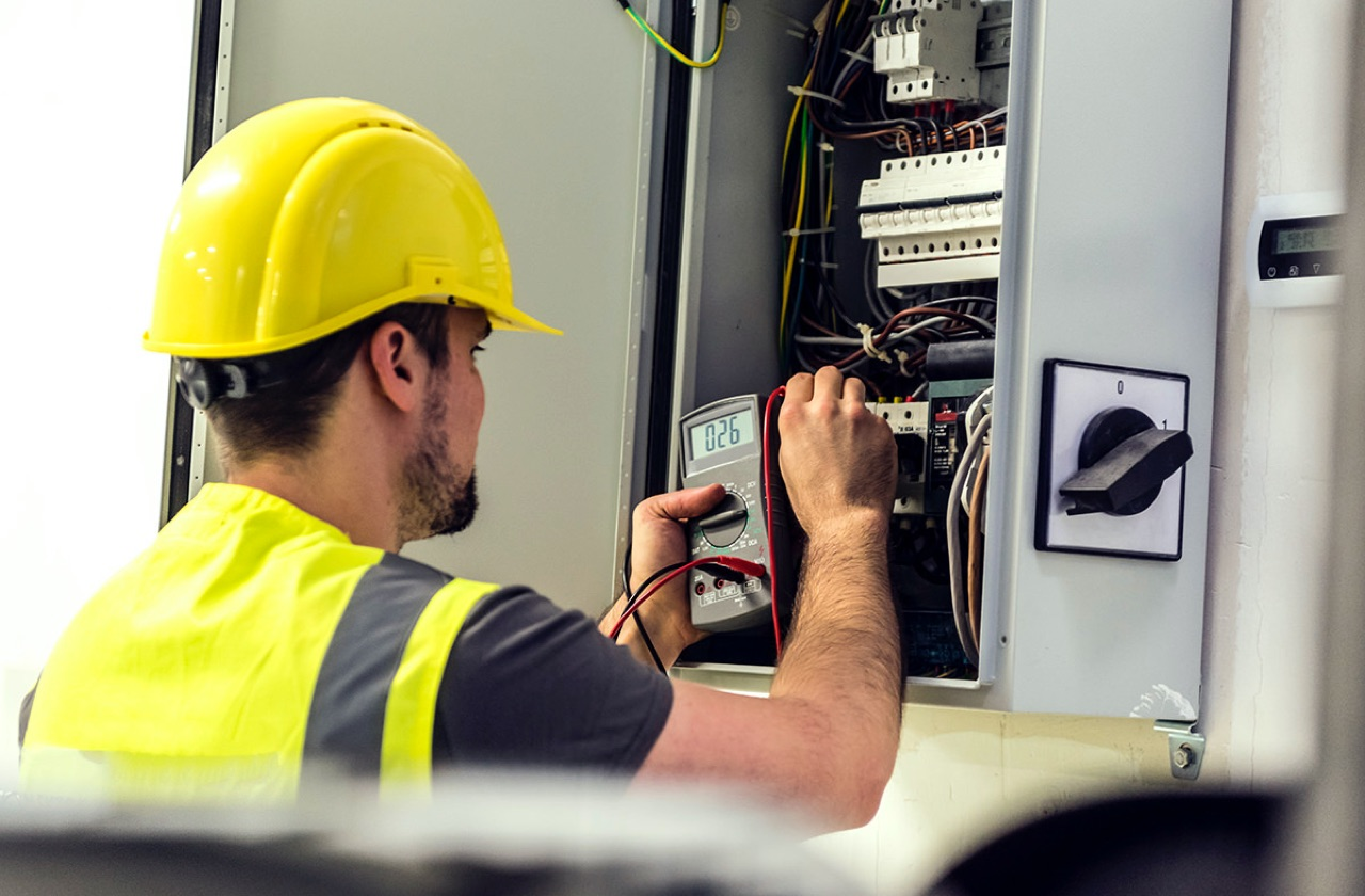 electrician working in fuse box