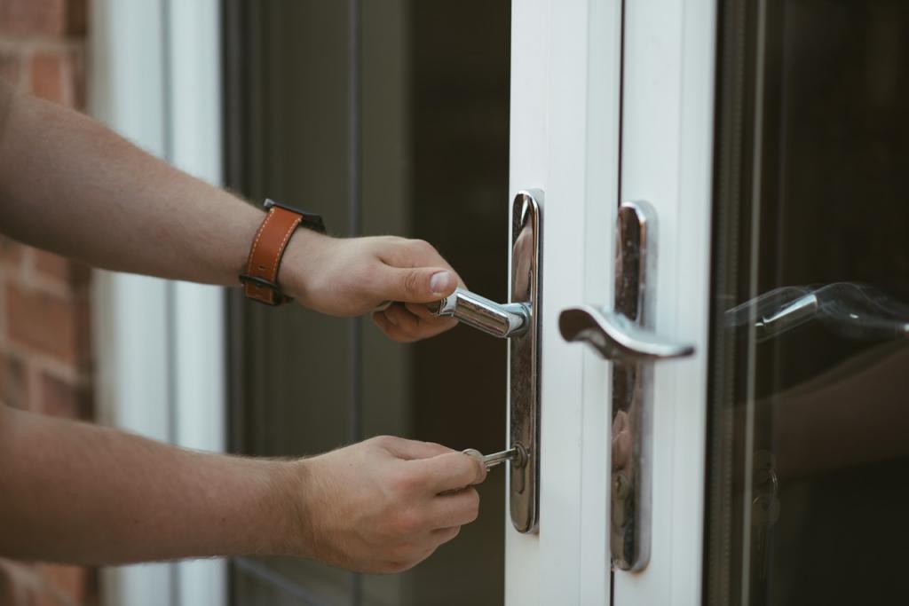 Homeowner inserting key in front door